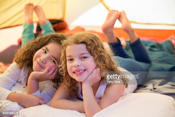 Girls smiling in camping tent