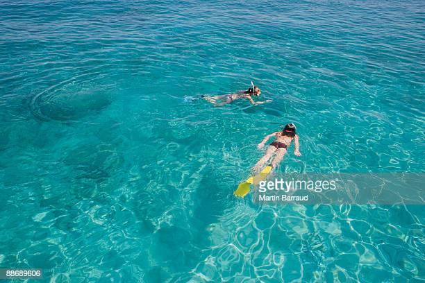 Girls snorkeling in ocean