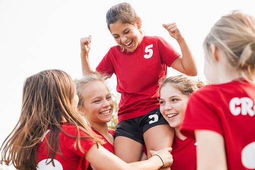 Girls soccer team celebrating victory - gettyimageskorea