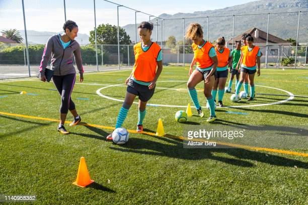 girls soccer team training - sports training drill stock pictures, royalty-free photos & images