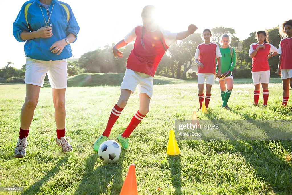 Girls soccer team training : Stock Photo