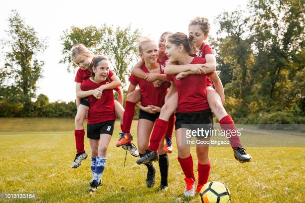 girls soccer team walking on field - soccer team stock pictures, royalty-free photos & images