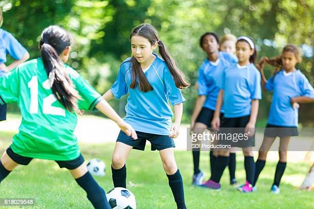 girls' soccer teams face off - face off sports play stock photos and pictures