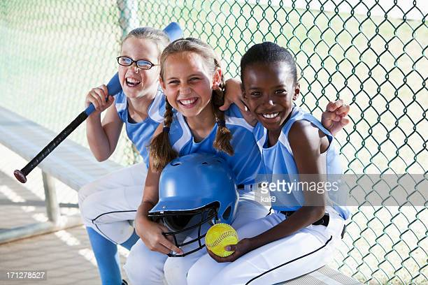 girls softball team sitting in dugout - baseball sport stock pictures, royalty-free photos & images