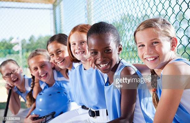 girls softball team sitting in dugout - youth sports competition stock pictures, royalty-free photos & images