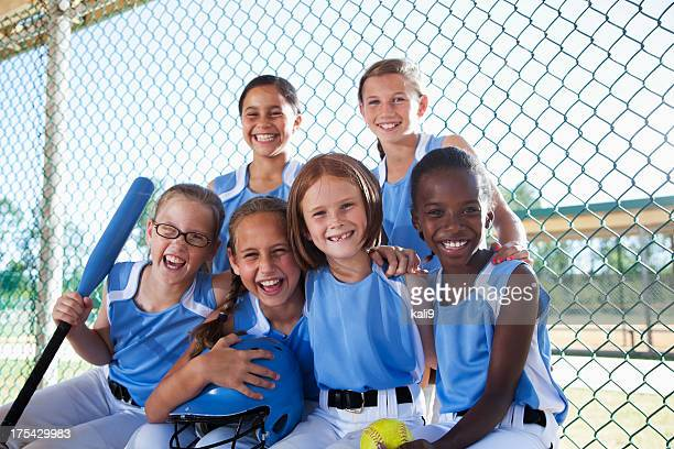 girls softball team sitting in dugout - softball sport stock pictures, royalty-free photos & images