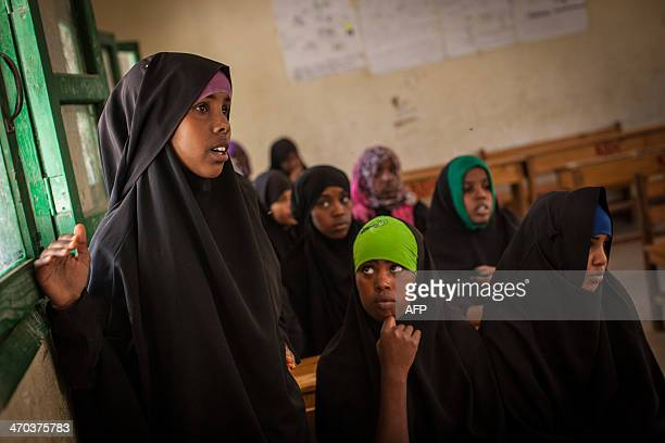 A girls speaks as she takes part with other young women and men in a discussion on female genital mutilation at an after school program for...