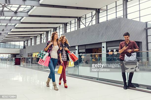 Girls spending the weekend in the shopping mall