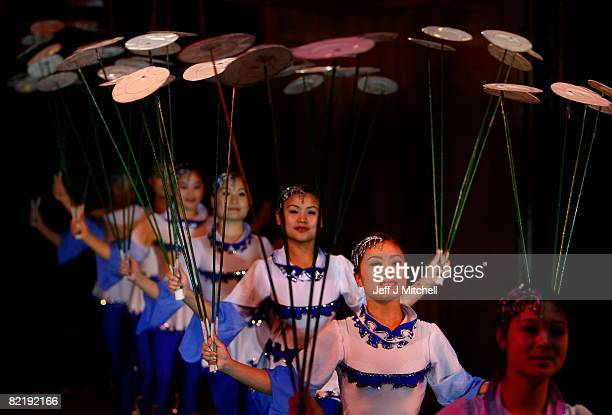 Girls spin plates during a performance at the Chinese State Circus on August 6, 2008 in Edinburgh, Scotland. A 2000 year old tradition of circus...
