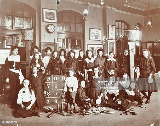 Girls sports club members, Cromer Street School/Argyle School, St Pancras, London, 1906. A group of girls pose in the hall with a range of sporting...
