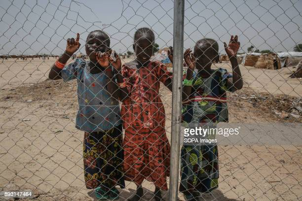 Girls stand against a fence in Muna Garage IDP camp More than two million people have been displaced during the conflict with Boko Haram