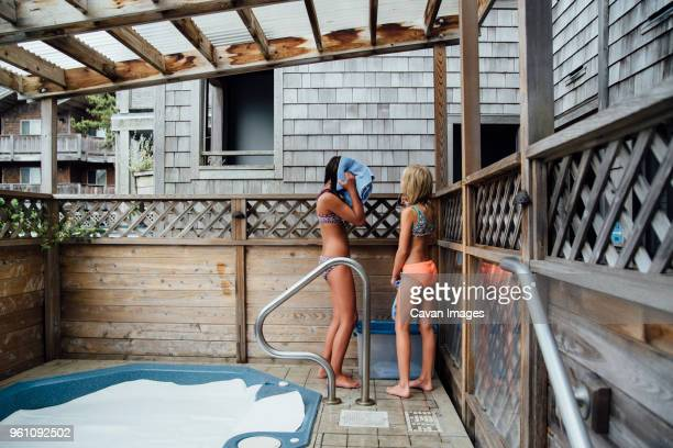 girls standing by hot tub at tourist resort - girls in hot tub stock photos and pictures
