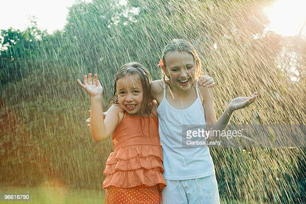 Girls standing in rain