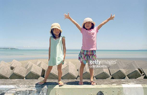 Girls standing on bank