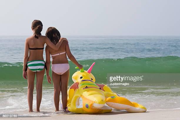 Girls standing on beach