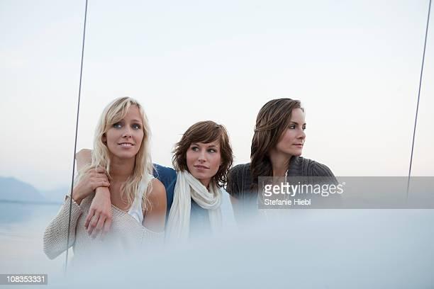 Girls standing on boat