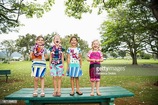 Girls standing together on picnic table