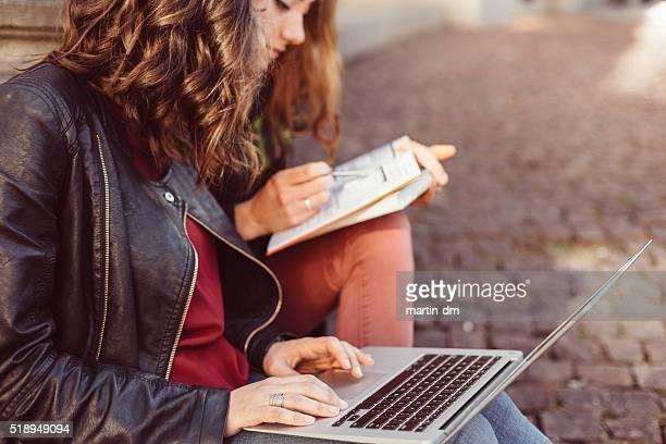 Girls studying outside