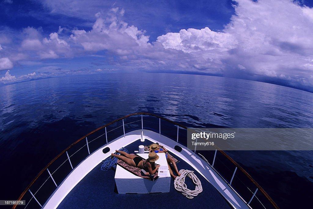 Girls Sunbathing On Boat : Stock Photo