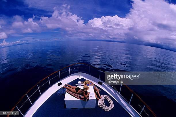 Girls Sunbathing On Boat