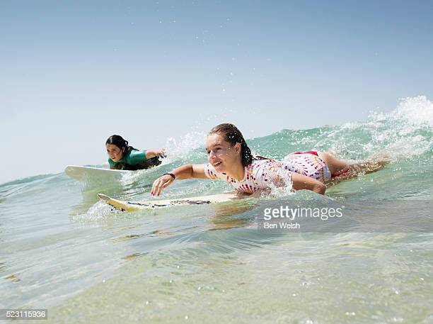 Girls surfing