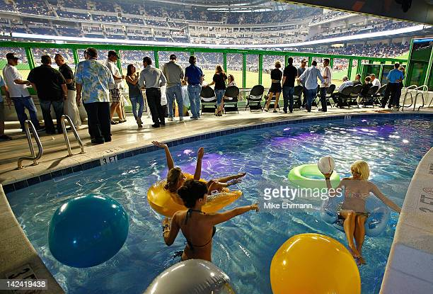 Girls swim in the Clevlander pool during Opening Day between the Miami Marlins and the St. Louis Cardinals at Marlins Park on April 4, 2012 in Miami,...