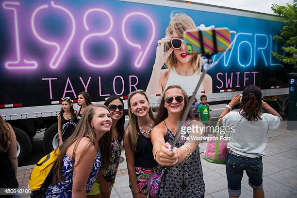 Girls take a selfie in front of a tour trailer before Taylor Swift preforms a concert at the Washington Nationals Stadium in Washington DC on Monday...