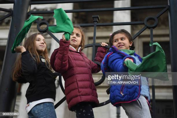 Girls take part in a demonstration by Argentine actresses along with dozens of other prochoice activists outside the Argentine Congress in Buenos...