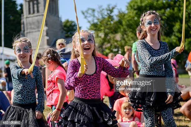 Girls take part in a Maypole dance at Camp Bestival at Lulworth Castle on August 2 2014 in Wareham United Kingdom