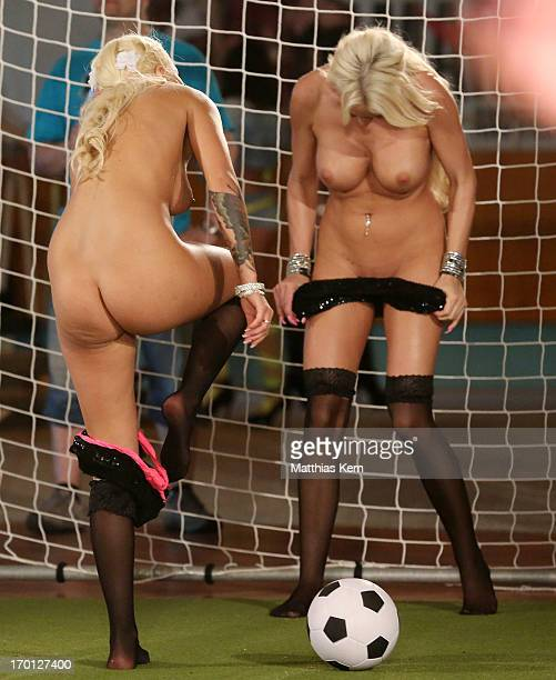 Girls take their clothes off during the first women's naked soccer European Championship at 'Palais am Funkturm' on June 7 2013 in Berlin Germany