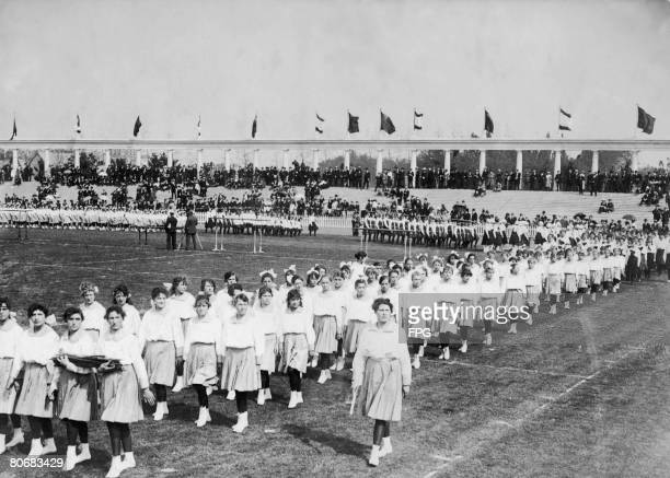 Girls taking part in a parade at the opening ceremony of the Antwerp Olympics at the Olympisch Stadion 20th April 1920