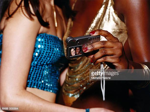 girls taking self portrait - girls flashing camera stock pictures, royalty-free photos & images