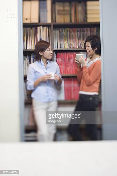 Girls Talking in Office