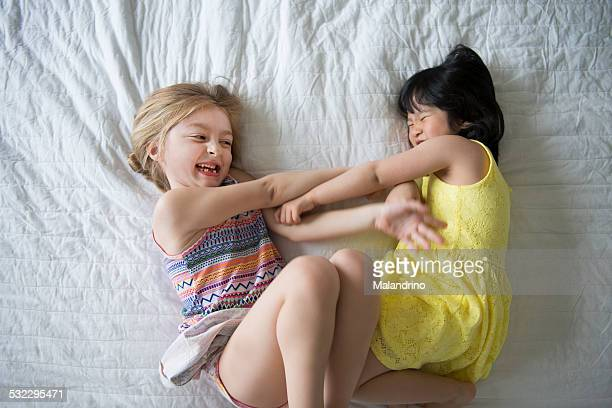 Girls Tickling Each Other