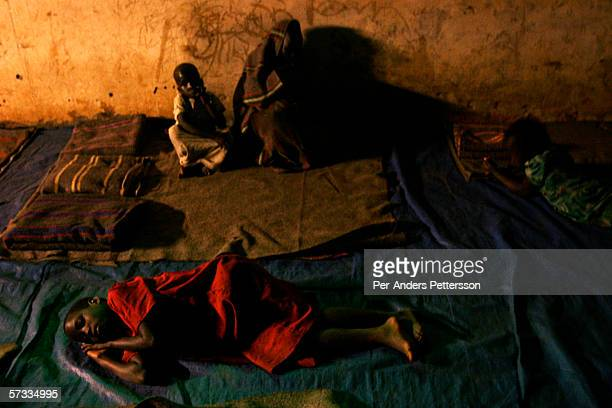 Girls tries to sleep in a shelter after walking from their villages on May 26 2005 in Gulu Uganda They are some of about 20000 night commuters that...