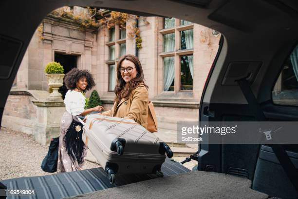 girl's trip - hotel stock pictures, royalty-free photos & images