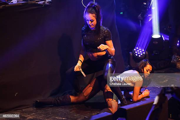 Girls twerk on stage as recording artist BoB performs at Billboard Winterfest at Park City Live on January 22 2015 in Park City Utah