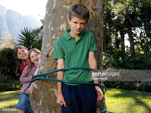 Multiple girls tie up and gag a boy Tied To Tree Photos And Premium High Res Pictures Getty Images