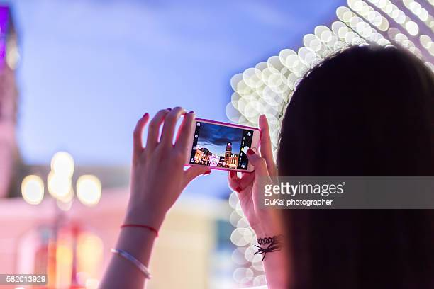 Girls use the phone to take pictures