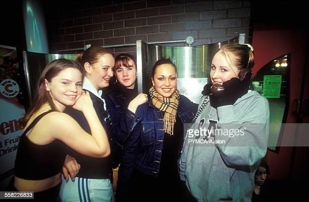 Girls using a payphone Gap hoody Denim jacket Burbury scarf Adidas tracksuit trousers Club It 20/11/99