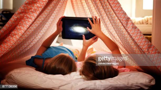 Girls using digital tablet.