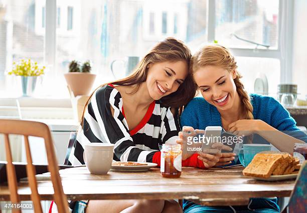 Girls using smart phones