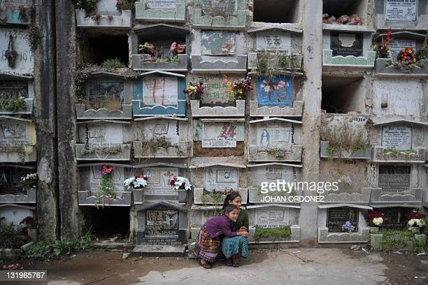 Girls visit the General cemetery in Guatemala City where a relative is buried, during the celebration of All Saints Day, on November 1, 2011. AFP...