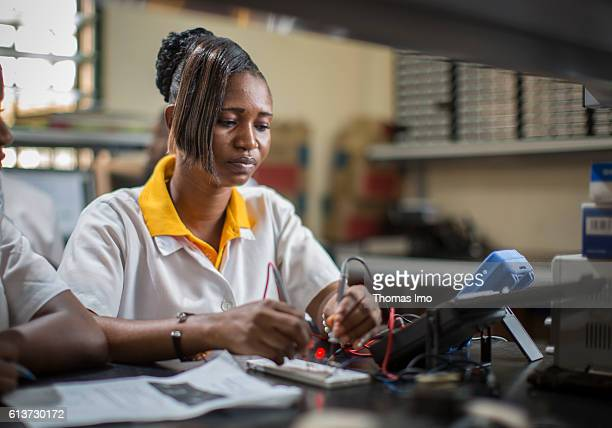 Girls Vocational Training Institute a vocational school in which African girls are trained in electrical engineering Here a student measures the...