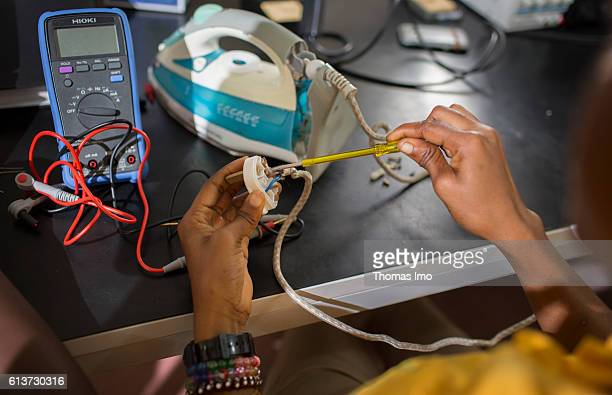 Girls Vocational Training Institute a vocational school in which African girls are trained in electrical engineering Here a student repairs an iron...