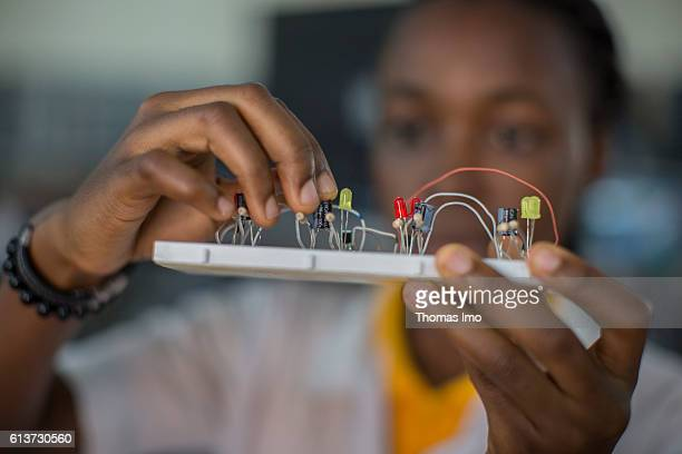 Girls Vocational Training Institute a vocational school where girls are taught in electrical engineering Here a pupil poses with a circuit in her...