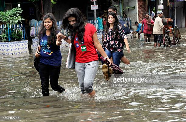 Girls wade through 2 feet deep water at Amherst Street on July 10 2015 in Kolkata India A heavy rainfall of 144 mm was recorded in the last 24 hours...