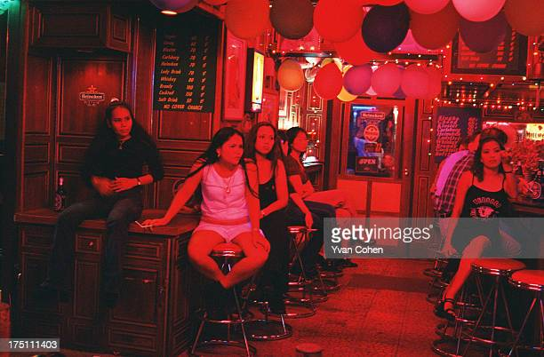 Girls wait for customers at an outdoor bar in the infamous Patpong road red light district in central Bangkok Visits to the red light district which...