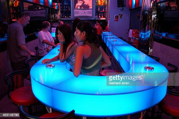 Girls waiting for customers in an almost empty bar on Walking Street Pattaya is a seaside resort city a couple of hours east of Bangkok that is very...