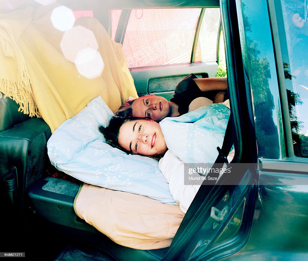 Girls waking up in car : Stock Photo